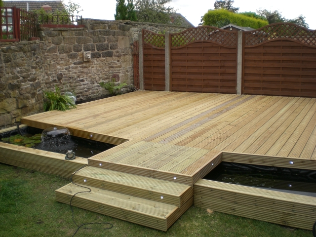 1000 images about backyard landscaping on pinterest for Deck pond ideas