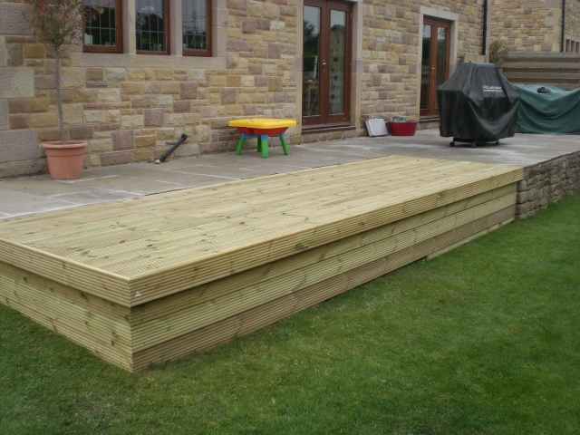 Sheffield landscaper gallery patios decking ponds fencing for Tanalised timber decking