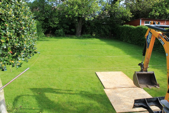 Sheffield landscaper gallery patios decking ponds fencing for Decking at end of garden